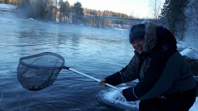 Guided fishing at Kuusaa rapids for Varjola Resort & Activities